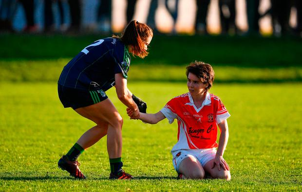 Aedin Murray of Foxrock-Cabinteely commiserates with Cora Courtney of Donaghmoyne. Photo by Brendan Moran/Sportsfile