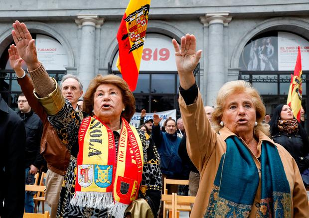 Hail Franco: Supporters of Spain's late dictator Francisco Franco give fascist salutes during a gathering for the anniversary of his death in Madrid. Photo: REUTERS