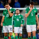 Pain of defeat: A dejected Stuart Dallas and Jonny Evans after Austria's second goal. Photo: Jason Cairnduff/Action Images via Reuters