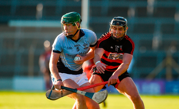 Ronan Lynch of Na Piarsaigh in action against Pauric Mahony of Ballygunner. Photo by Diarmuid Greene/Sportsfile