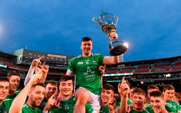 Limerick captain Declan Hannon is held aloft by his team mates as they celebrate with the cup after winning the Fenway Hurling Classic 2018 Final match between Cork and Limerick at Fenway Park in Boston, MA, USA. Photo by Piaras Ó Mídheach/Sportsfile
