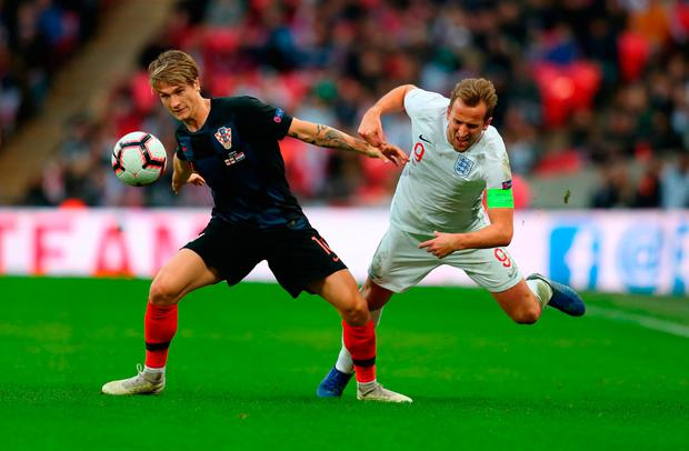 Harry Kane of England is challenged by Tin Jedvaj of Croatia. Photo by Catherine Ivill/Getty Images