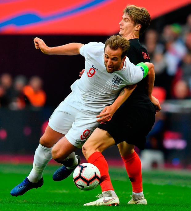 England's striker Harry Kane (L) vies with Croatia's defender Tin Jedvaj (R). Photo: Getty Images