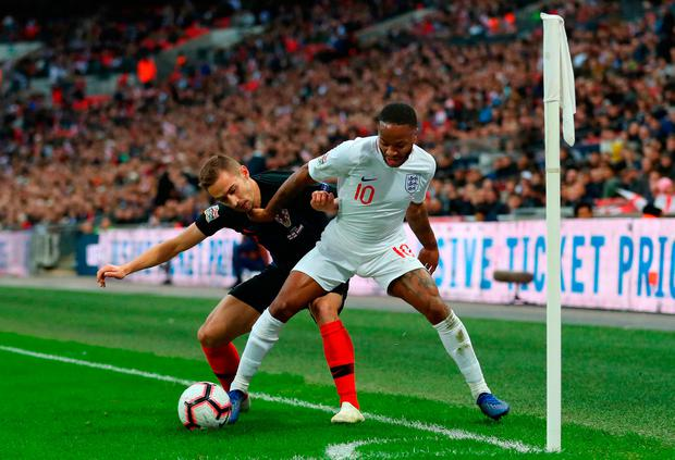 Marko Rog of Croatia battles for possession with Raheem Sterling of England. Photo by Catherine Ivill/Getty Images