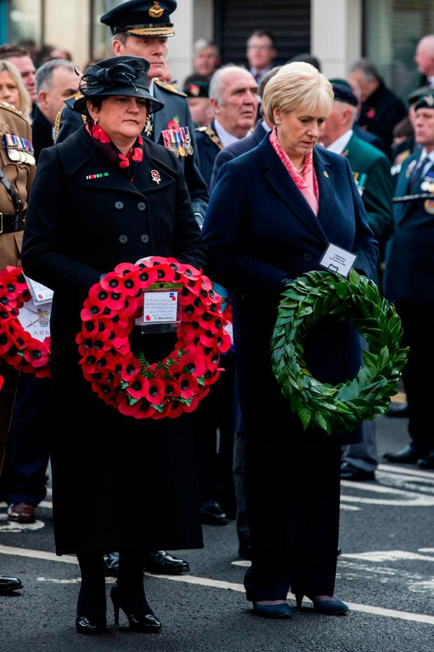 Shared history: DUP leader Arlene Foster (left) and Heather Humphreys at the Enniskillen Cenotaph. Picture: PA