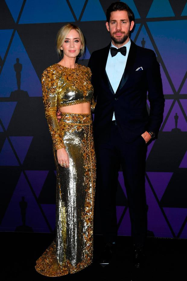 British actress Emily Blunt and US actor John Krasinski (R) attends the 10th Annual Governors Awards gala hosted by the Academy of Motion Picture Arts and Sciences at the the Dolby Theater at Hollywood & Highland Center in Hollywood, California on November 18, 2018. (Photo by VALERIE MACON / AFP)