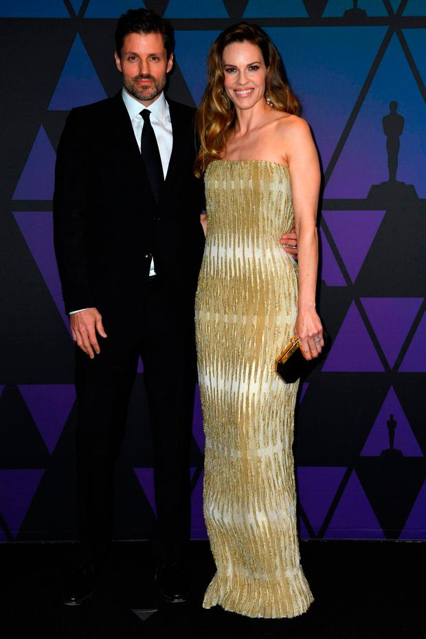 US actress Hilary Swank and Philip Schneider attend the 10th Annual Governors Awards gala hosted by the Academy of Motion Picture Arts and Sciences at the the Dolby Theater at Hollywood & Highland Center in Hollywood, California on November 18, 2018. (Photo by VALERIE MACON / AFP)