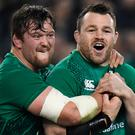 Ireland's Andrew Porter and Cian Healy celebrate after the match. REUTERS/Clodagh Kilcoyne