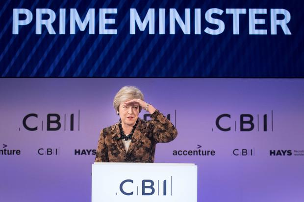 Theresa May defended her Brexit plans to business chiefs at the CBI conference (Stefan Rousseau/PA)