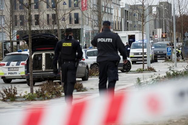 Police are seen, after a man was hit by a police shot in Brabrand, when he attacked a patrol with a knife in Aarhus West Photo: Reuters
