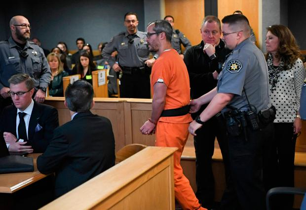Christopher Watts is brought into court for his sentencing hearing at the Weld County Courthouse on Monday, Nov. 19, 2018 in Greeley, Colo. Watts received three consecutive life sentences without a chance at parole on Monday, nearly two weeks after pleading guilty to avoid the death penalty. (RJ Sangosti/The Denver Post via AP, Pool)
