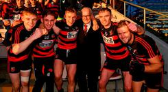 Ballygunner supporter Pat O'Sullivan celebrates with his grandsons Mikey Mahony, Tadhg Foley, Philip Mahony, Pauric Mahony, and Barry O'Sullivan who were on the panel for the Munster final victory over Na Piarsaigh. Photo: Diarmuid Greene/Sportsfile