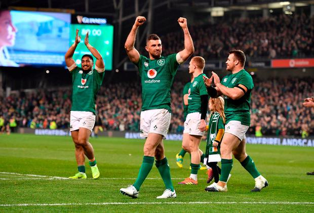 Rob Kearney and co celebrate after beating the All Blacks at the Aviva Stadium on Saturday. Photo: Charles McQuillan/Getty Images