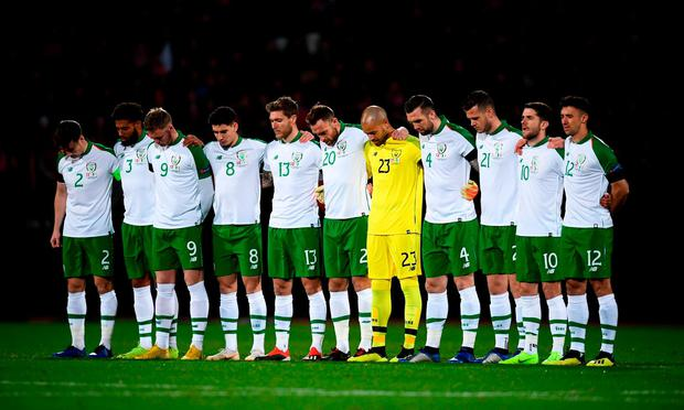 Silence: The Ireland team observe a minute's silence prior to the match with Denmark as a mark of respect to David Clerkin. Photo: Stephen McCarthy/Sportsfile