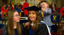 Recognised: Vicky Phelan, with children Darragh and Amelia, was handed an honorary fellowship by Waterford Institute of Technology