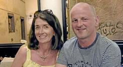 On the mend: Seán Cox, with his wife Martina, was seriously injured during an assault at Liverpool's Champions League semi-final clash with Roma last April