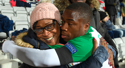 Michael Obafemi embracing his mother Bola after the final whistle. Photo: Stephen McCarthy/Sportsfile