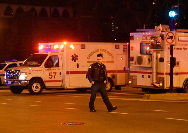 A Chicago police officer works the scene after a gunman opened fire at Mercy Hospital, Monday, Nov. 19, 2018, in Chicago. A police spokesman said the gunman was dead, but it was not immediately clear if he took his own life or was killed by police at the hospital on the city's South Side. (AP Photo/David Banks)