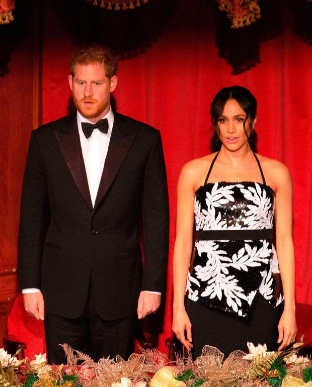 Britain's Prince Harry (L), Duke of Sussex, and his wife Meghan, Duchess of Sussex, attend the annual Royal Variety Performance at the Palladium Theatre in central London on November 19, 2018. (Photo by Ian Vogler / POOL / AFP)