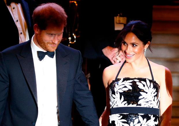 3399857e Britain's Prince Harry and Meghan, the Duchess of Sussex, leave after the  Royal Variety