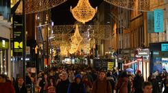 Shoppers are checking products and prices on Grafton Street ahead of the Black Friday