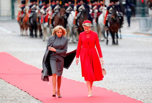 Belgian Queen Mathilde talks with Brigitte Macron, the wife of French President, as she arrives at Brussels' Royal Palace, on the first day of an official state visit, in Brussels, Belgium November 19, 2018. REUTERS/Yves Herman