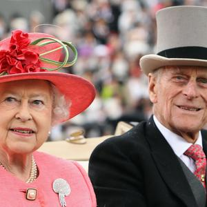 ASCOT, ENGLAND - JUNE 16: Queen Elizabeth ll and Prince Philip, Duke of Edinburgh arrive in an open carriage on Ladies Day at Royal Ascot on June 16, 2011 in Ascot, England. The five-day meeting is one of the highlights of the horse racing calendar, with 2011 marking the 300th anniversary of the annual event. Horse racing has been held at the famous Berkshire course since 1711. (Photo by Dan Kitwood/Getty Images)