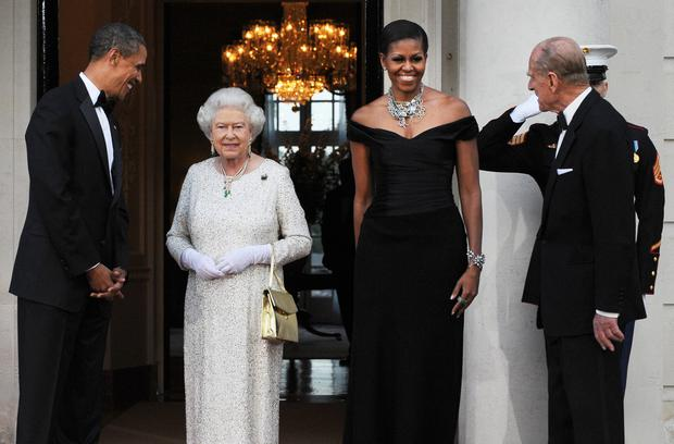 US President Barack Obama (L) and First Lady Michelle Obama (2nd-R) greet Britain's Queen Elizabeth II (2nd-L) and Prince Philip, the Duke of Edinburgh, for a reciprocal dinner at the Winfield House in London, on May 25, 2011