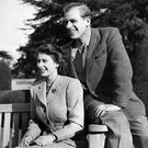 Britain's Princess Elizabeth (future Queen Elizabeth II) and her husband Philip, Duke of Edinburgh, pose during their honeymoon, November 25, 1947 in Broadlands estate, Hampshire. (Photo by - / - / AFP) (Photo credit should read -/AFP/Getty Images)
