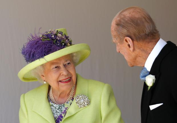 Britain's Queen Elizabeth II (L) talks with Britain's Prince Philip, Duke of Edinburgh (R) as they leave after attending the wedding ceremony of Britain's Prince Harry, Duke of Sussex and US actress Meghan Markle at St George's Chapel, Windsor Castle, in Windsor, on May 19, 2018. (Photo by Alastair Grant / POOL / AFP) (Photo credit should read ALASTAIR GRANT/AFP/Getty Images)