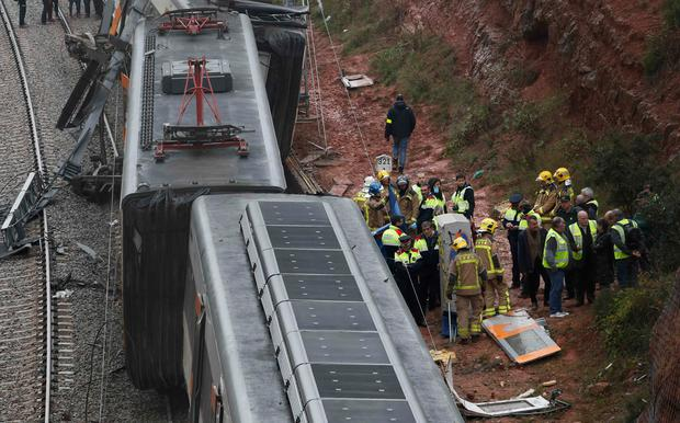 Barcelona crash: One dead and 44 hurt after landslide DERAILS train