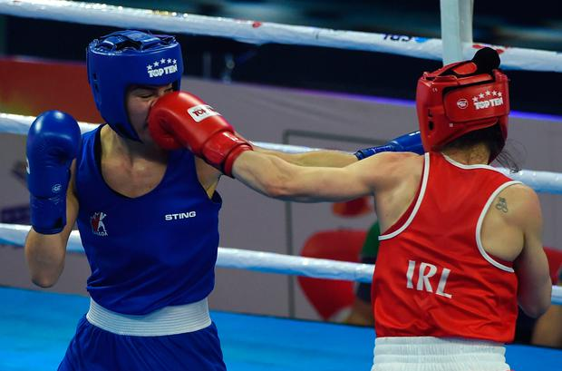Kellie Harrington on the way to beating Caroline Veyre of Canada in the quarter-finals of the Women's World Elite Championships in New Delhi