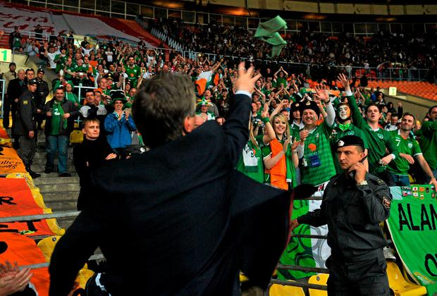 John Delaney throwing his tie into the crowd after a draw against Russia in 2011. Photo: David Maher/SPORTSFILE