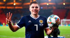 Scotland's James Forrest celebrates with the matchball after scoring a hat-trick against Israel at Hampden Park. Photo: PA