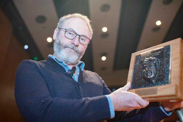 Honour: Liam Cunningham shows off the DIT Brendan Behan Award for his outstanding contribution to the arts. Photo: Arthur Carron