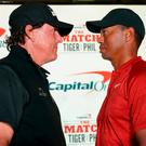 Phil Mickelson (left) and Tiger Woods (right) pose for a photo during a press conference before The Match: Tiger vs Phil golf match at Shadow Creek Golf Course. Mandatory Credit: Kyle Terada-USA TODAY Sports