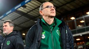 Martin O'Neill stands for the anthem in Denmark prior to what proved to be his final game in charge. Photo: PA Wire