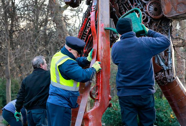 Park staff clean off the red paint which was daubed on the 'Hauntings Soldier' at St Stephen's Green. Picture: Frank McGrath
