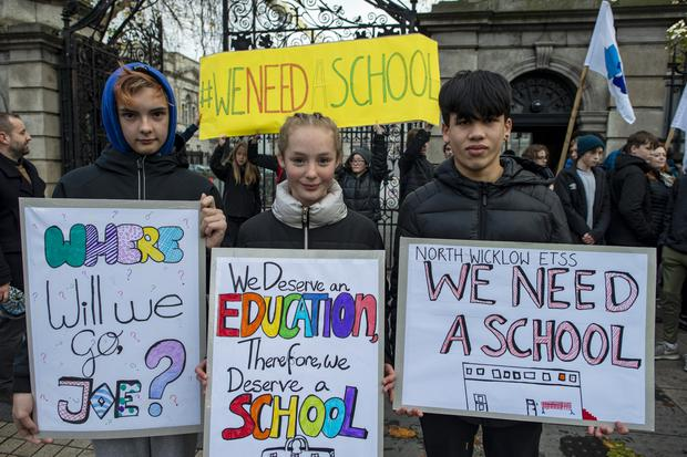 Josh Coster (13), Abby Harington (14), and Patrick Phibbs (13) from North Wicklow Educate Together secondary school protest outside the Dáil. Photo: Douglas O'Connor