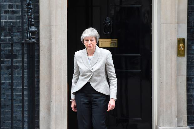 Prime Minister Theresa May leaves 10 Downing Street, London to make statement about Brexit. Photo: David Mirzoeff/PA Wire