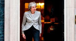 Opening the door: UK Prime Minister Theresa May prepares to greet Austrian Chancellor Sebastian Kurz at 10 Downing Street yesterday. Photo: Jack Taylor/Getty Images