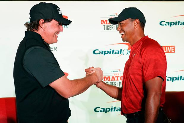 Laughing all the way to the bank: Phil Mickelson and Tiger Woods shake hands during a press conference ahead of The Match. Photo: Kyle Terada-USA TODAY Sports