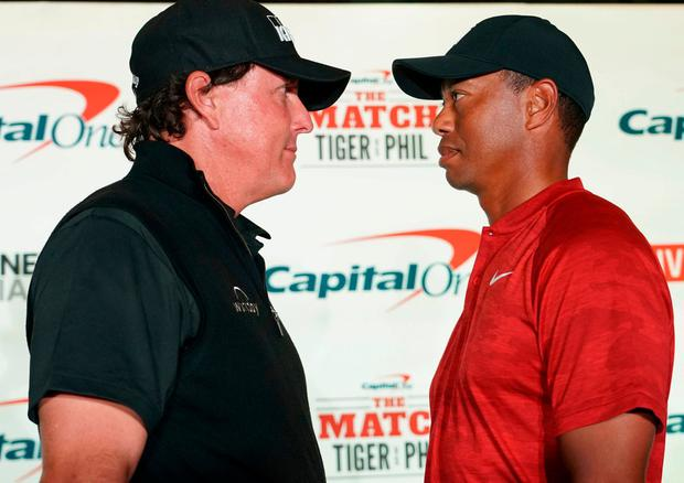 Phil Mickelson (left) and Tiger Woods (right) pose for a photo during a press conference before The Match. Credit: Kyle Terada-USA TODAY Sports