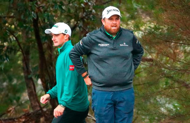 Shane Lowry and Paul Dunne of Ireland talk on the 9th hole during day two of the 2018 World Cup of Golf at The Metropolitan on November 23, 2018 in Melbourne, Australia. (Photo by Scott Barbour/Getty Images)