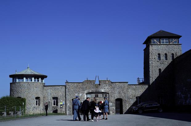 FILE PHOTO: People arrive at the memorial site of the former concentration camp Mauthausen ahead of the commemoration ceremony of liberation, Mauthausen, Austria May 06, 2018. REUTERS/Lisi Niesner/File Photo