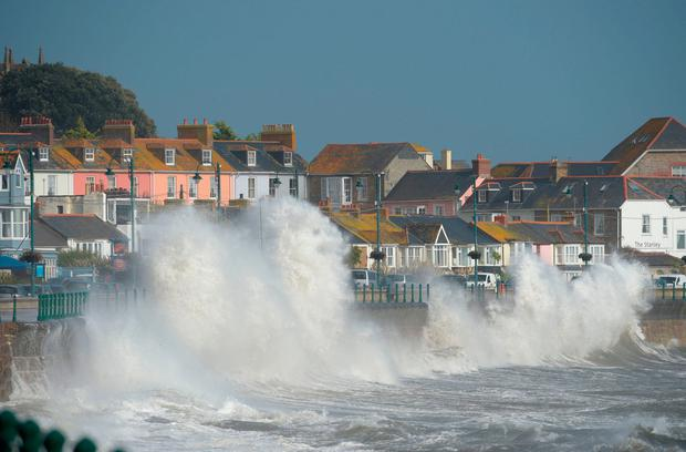 Extremes: Waves hit the shore during Storm Ophelia last year. Photo: PA