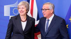 Endgame: British Prime Minister Theresa May and EC President Jean-Claude Juncker in Brussels earlier this week. Photo: Getty