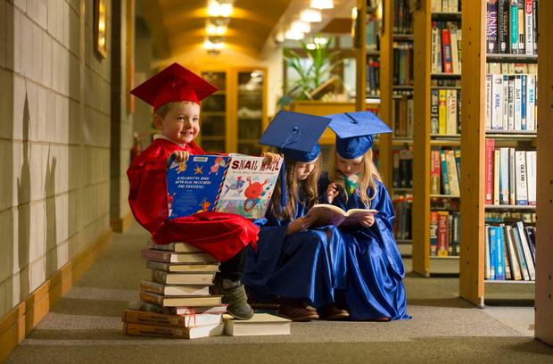 Pictured at the library at Waterford Institute of Technology are Diarmaid Shortall (3) with Ava (3) and her sister Anna Pierce (7) getting ready for Library Week. Picture: Patrick Browne