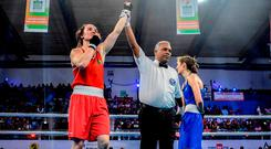 Kellie Harrington has her hand raised in victory after her semi-final. Photo: AIBA/Sportsfile
