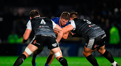 Leinster's Scott Penny is tackled by Giorgi Nemsadze and Tom Botha of Ospreys during their PRO14 clash Photo: Harry Murphy/Sportsfile